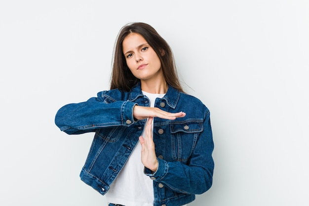 Young cute woman showing a timeout gesture.