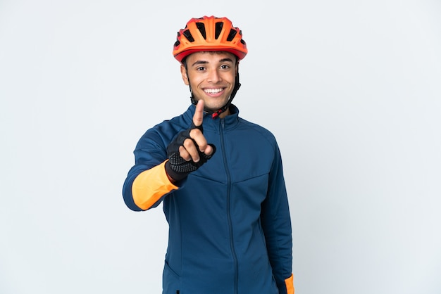 Young cyclist brazilian man on white showing and lifting a finger