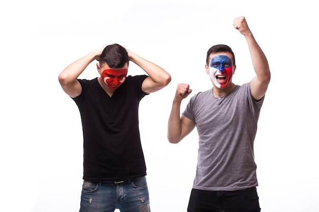 Young czech and tunisian football fans win and lose emotions isolated on white wall