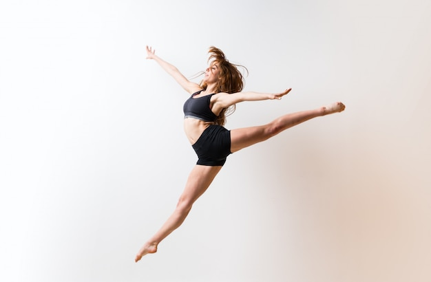 Young dance girl over isolated white wall