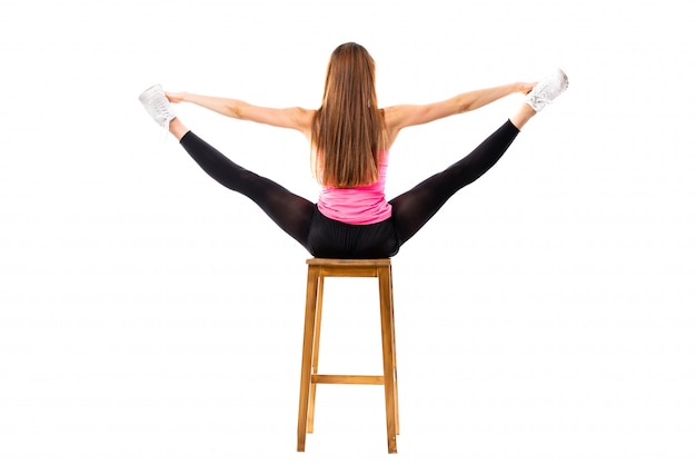 Young dance girl stretching isolated