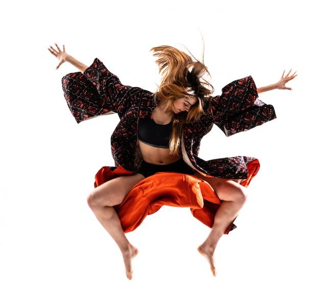 Young dance girl with kimono jumping