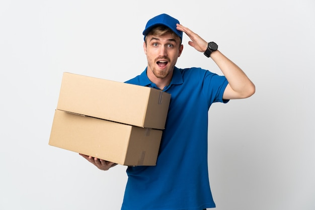Young delivery blonde man isolated with surprise expression