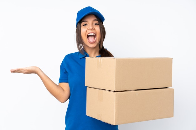 Young delivery brunette girl over isolated white wall with shocked facial expression