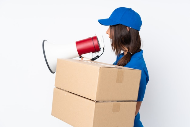 Young delivery brunette woman shouting through a megaphone