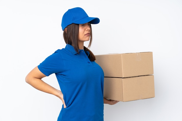 Young delivery brunette woman suffering from backache for having made an effort