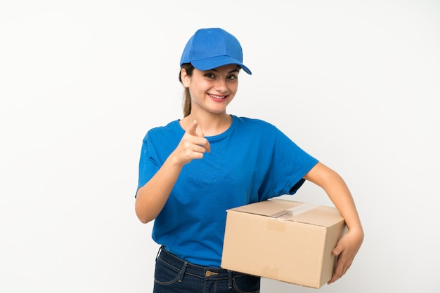 Young delivery girl over isolated white  points finger at you