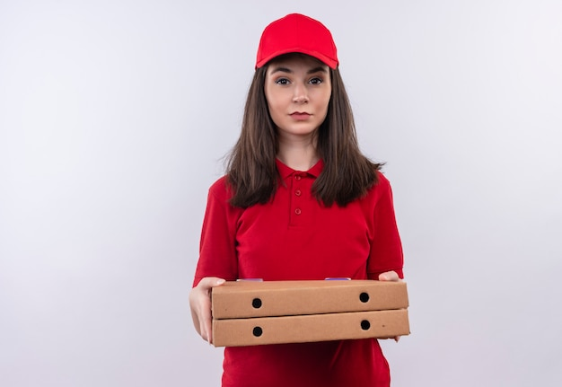 Young delivery girl wearing red t-shirt in red cap holding a pizza box on isolated white background