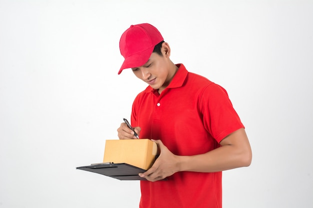 Young delivery man checking list on clipboard isolated on white background