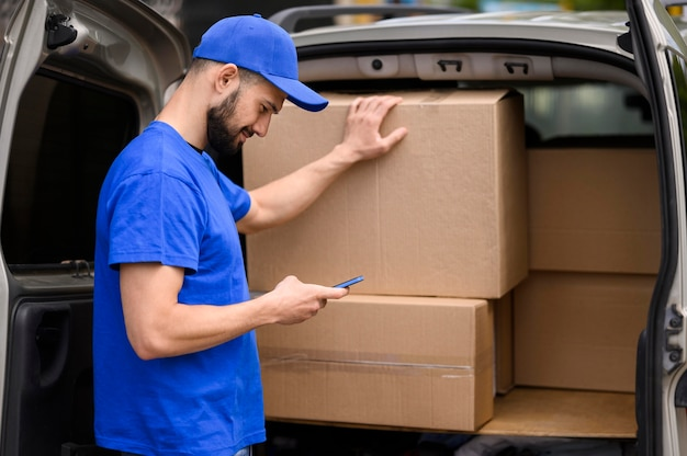 Young delivery man verifying shipment