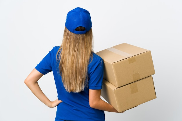 Young delivery woman over isolated white background in back position