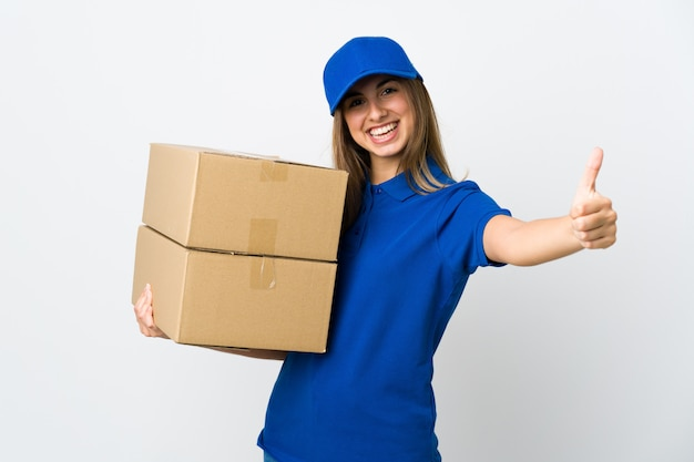 Young delivery woman over isolated white background giving a thumbs up gesture