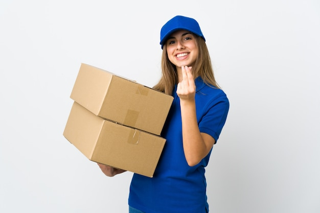 Young delivery woman over isolated white background making money gesture