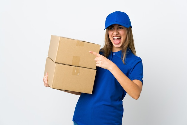 Young delivery woman over isolated white background pointing finger to the side and presenting a product