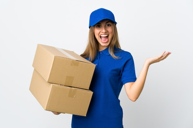 Young delivery woman over isolated white background with shocked facial expression