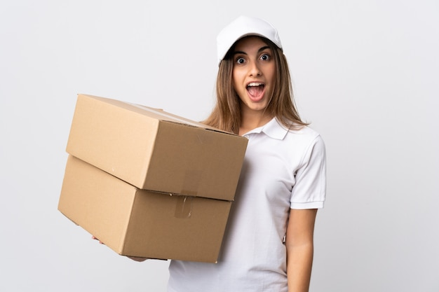 Young delivery woman over isolated white background with surprise facial expression
