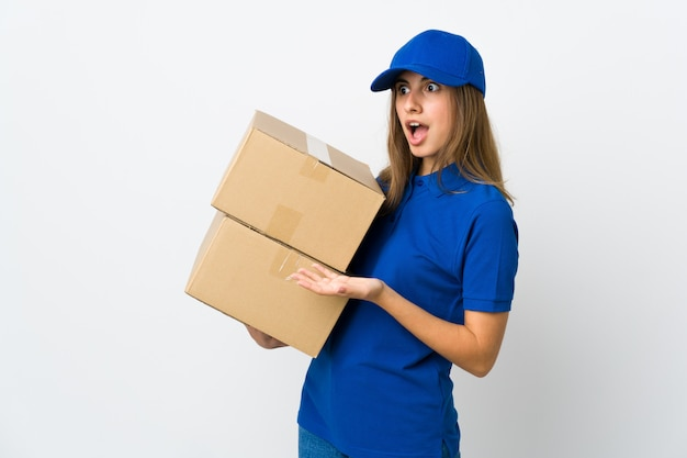 Young delivery woman on isolated white with surprise expression while looking side