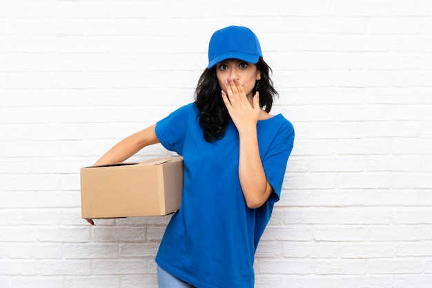 Young delivery woman with surprise facial expression