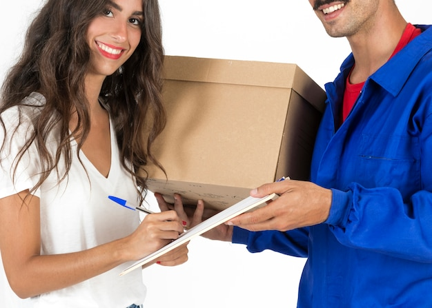 Young deliveryman with box