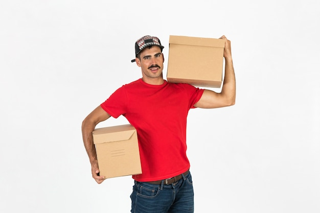 Young deliveryman with boxes