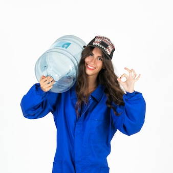 Young deliverywoman with water carafe