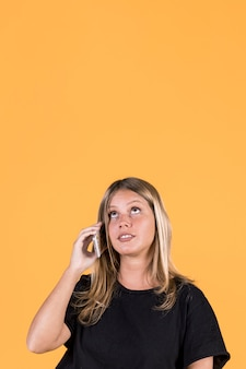 Young disable woman talking on mobile phone
