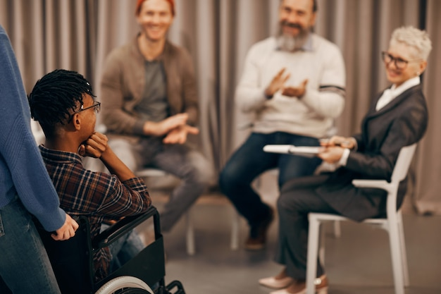 Young disabled man visiting training class