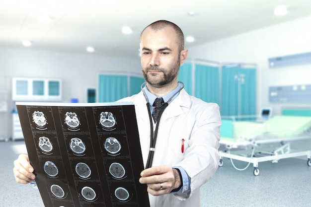 Young doctor examines an xray inside the hospital.