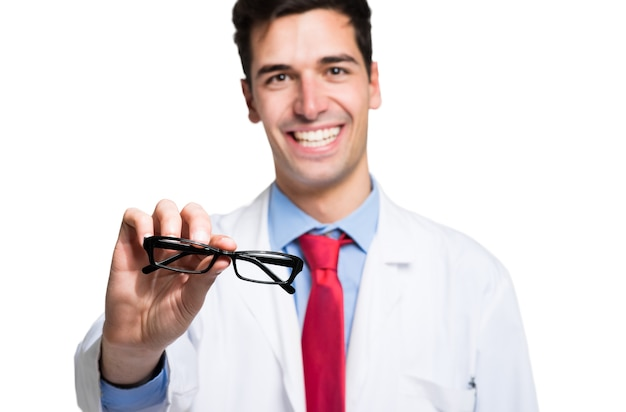 Young doctor giving you a pair of eyeglasses