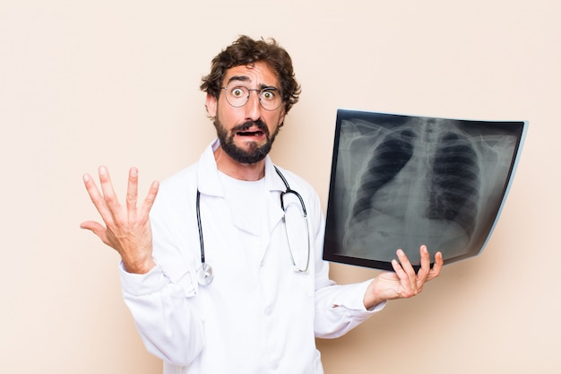 Young doctor holding a bone scan