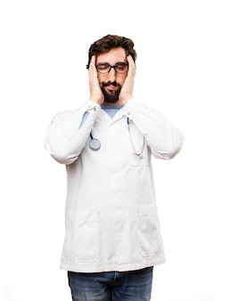 Young doctor man boring expression