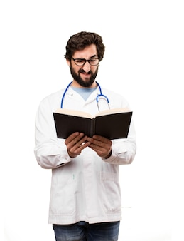 Young doctor man with a book