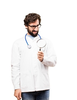 Young doctor man with a magnifying glass