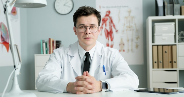 Young doctor sitting in medical office