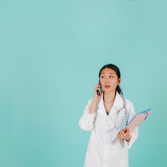 Young doctor speaking on phone