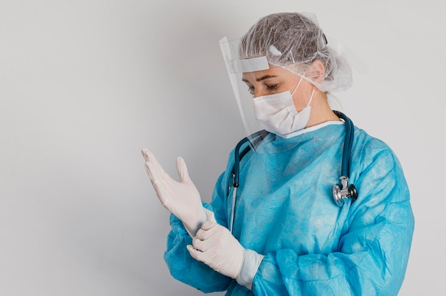 Young doctor wearing surgical gloves