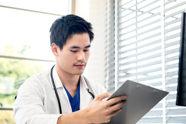 Young doctor working in his office