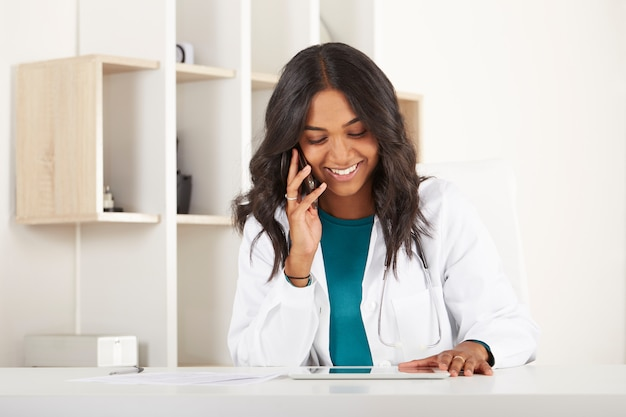 Young doctor working in office