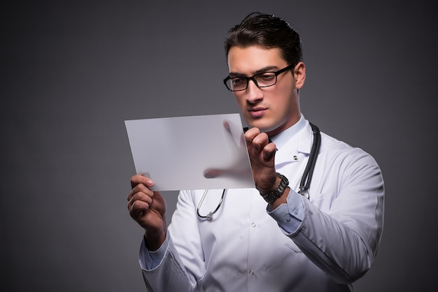 Young doctor working on tablet computer