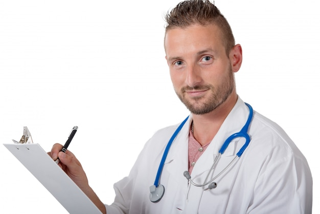 Young doctor writing on a notepad on white