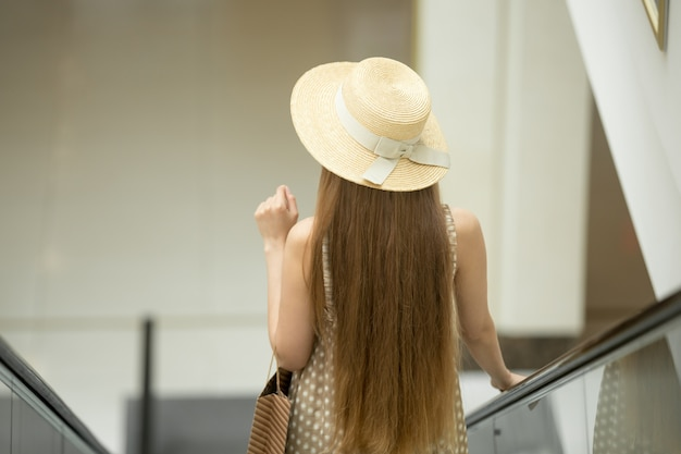 Young down an escalator girl