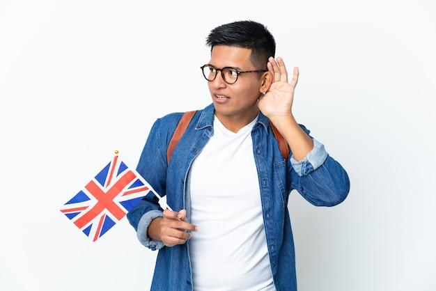 고립 된 영국 국기를 들고 젊은 에콰도르 여자