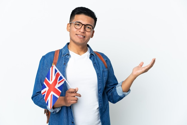 Young ecuadorian woman holding an united kingdom flag isolated on white background extending hands to the side for inviting to come