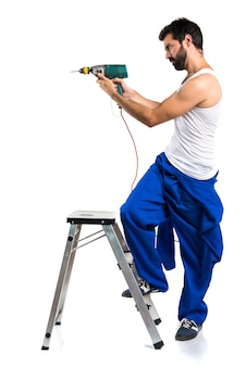 Young electrical technician with a drill