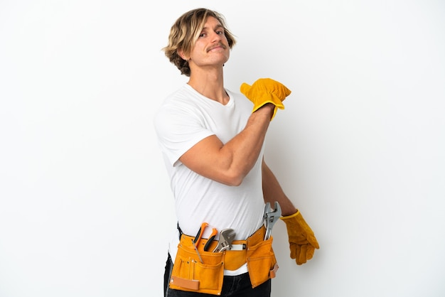 Young electrician blonde man isolated on white wall proud and self-satisfied