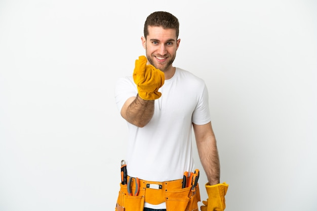 Young electrician man over isolated white wall making money gesture