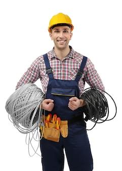 白い背景の上のツールを持つ若い電気技師