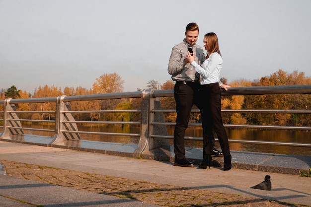 Young and elegant couple in love - autumn park