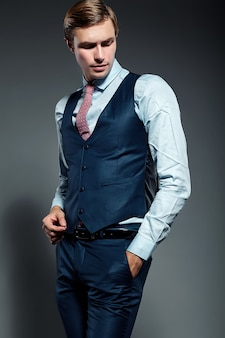 Young elegant handsome businessman male model in blue suit