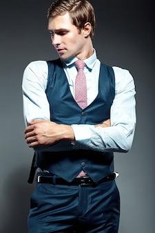 Young elegant handsome businessman male model in blue suit